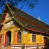 A monk enters the Wat Si Muang in Vientiane. The spot for this monastery was chosen in 1563