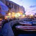 Night-life: Fishing boats moored in the harbour, while people eat out along the waterfront - Rethymno, Rethymno Province, Crete
