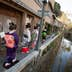 SHIMODA, JAPAN - DECEMBER 14:  Trainee geisha women, known as 'maiko', walk beside a canal on Perry Road, on December 14, 2011 in Shimoda, Japan. Shimoda, a Japanese fishing town, advertised for three women to train as geisha after their numbers fell dramatically. Once qualified in March 2012, they will work in an initiative to revive the geisha culture and rejuvenate the local tourism industry. (Photo by Jeremy Sutton-Hibbert/Getty Images)