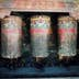 Weathered old prayer wheels at Sakya Monastery.