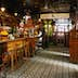Interior of the Crown Liquor Saloon bar area which features ornate glass, tile and wooden decoration and furnishings, Belfast.