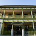 """NAGASAKI, NAGASAKI-KEN, JAPAN - 2010/07/20: The former Nagasaki International club built in 1903. Dejima, literally """"protruding island"""", was a small island in the bay of Nagasaki that was a Dutch trading post during Japan's self-imposed isolation of the Edo period from 1641 until 1853.  Here Dutch traders were stationed, keeping a small window on the outside world plus trade with the rest of the world..Since the closing of the Dutch East India Company's trading post in 1857, the island has been surrounded by reclaimed land and merged into Nagasaki. The island was designated a national historical site in 1922. Today, Dejima is a work in progress with the long-term plan to fully restore its characteristic fan-shaped form and all the embankment walls.. (Photo by John S Lander/LightRocket via Getty Images)"""