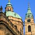 The towers of St Nicholas Church in Prague. Dienstenhofer, a German architect, built the church in an early 18th century Baroque style.