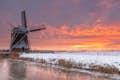 The Netherlands is windmills under vast skies