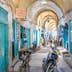 Kairouan, Tunisia - August 30, 2015: Almost all the stalls in Souq El-Blaghija market are closed after midday that's why it could be used as parking for cycles and scooters.