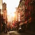 An image of a street scene at Pell Street in Chinatown / New York City / Manhattan with the setting sun.