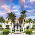 WEST PALM BEACH, FLORIDA - APRIL 4, 2016: The Flagler Museum exterior and grounds. The beaux arts mansion was constructed by Henry Flagler.; Shutterstock ID 402760483; Your name (First / Last): Lauren Keith; GL account no.: 65050; Netsuite department name: Content Asset; Full Product or Project name including edition: Guides Project Eastern USA