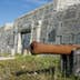 Parks Canada, National Historic Site of Canada, Prince of Wales Fort, Antique cannon in front of fort wall, Churchill, Manitoba, Canada
