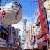 Colorful signs and Tsutenkaku tower in Osaka