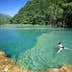 Visitors swimming in turquoise-coloured waters of Semuc Champey.