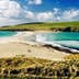 Sandbar, known as a tombolo, connecting St Ninian's Isle with the mainland of the Shetland Islands off the north of Scotland.