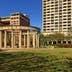 Mecom-Rockwell Fountain and Colonnade, Houston, Texas, United States. This 1968 Hermann Park monument is constructed of corinthian-style limestone columns from the original Miller Theatre. Also pictured Hotel ZaZa (fomer Warwick Hotel) and Warwick Towers (right). (Photo by: MyLoupe/UIG via Getty Images)