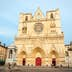 LYON, FRANCE - JUNE 5: Exterior of St. John the Baptist cathedal in Lyon downtown with people passing by. June 2015; Shutterstock ID 405341626; Your name (First / Last): Daniel Fahey; GL account no.: 65050; Netsuite department name: Online Editorial; Full Product or Project name including edition: Lyon BiT
