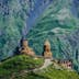 Gergeti, Georgia - July 20, 2015. One of the foremost Georgian landmarks - Tsminda Sameba church (english: Holy Trinity) near Gergeti town; Shutterstock ID 446367901; Your name (First / Last): Gemma Graham; GL account no.: 65050; Netsuite department name: Online Editorial; Full Product or Project name including edition: Georgia destination page masthead and POI images