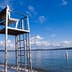 """""""Looking upwards at a lifeguard chair at Madison Park in Seattle, WA with Lake Washington in the background."""""""