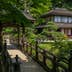 YOKOHAMA, KANAGAWA-KEN, JAPAN - 2015/05/06: Sankeien was once the private property of the silk baron Hara Sankei, and was opened to the public in 1904. Hara wanted to share the beauty of his fortune by opening up his grounds. The cherry blossoms in spring and maple leaves in autumn make Sankeien a favorite spot in Yokohama for both residents and visitors.  Besides the landmark three-storied pagoda, koi ponds, streams and an elegant feudal lords residence, numerous tea houses are scattered through the garden. (Photo by John S Lander/LightRocket via Getty Images)