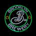 Neon sign at night: The Brooklyn Brewery beer logo is displayed in the front window of a bar in Prospect Heights, Brooklyn, NYC- February 28, 2015
