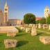 Roman forum and distant church inside old Venetian town, Zadar, Croatia; Shutterstock ID 218654365; Your name (First / Last): Emma Sparks; GL account no.: 65050; Netsuite department name: Online Editorial; Full Product or Project name including edition: Best in Europe POI updates