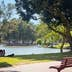 TEL AVIV, ISRAEL - May 6 2016: Lake, bench, girls with dog, and relax in Yarkon Park; Shutterstock ID 698891233; Your name (First / Last): Lauren Keith; GL account no.: 65050; Netsuite department name: Online Editorial; Full Product or Project name including edition: Tel Aviv Online Update