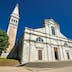 Rovinj, Croatia - May 22, 2018: St. Euphemia's Basilica, Rovinj, Croatia. Аn ancient church with a bell tower.; Shutterstock ID 1138512785; Your name (First / Last): Anna Tyler; GL account no.: 65050; Netsuite department name: Online Editorial; Full Product or Project name including edition: destination-image-southern-europe