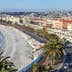 NICE, FRANCE, on JANUARY 9, 2017. Promenade des Anglais - the main embankment of the city, one of the most beautiful in the world, stretches along the sea and the beach. Aerial view from Shatto's hill; Shutterstock ID 613405820; Your name (First / Last): Daniel Fahey; GL account no.: 65050; Netsuite department name: Online Editorial; Full Product or Project name including edition: Nice and Graz POIs