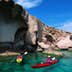 Kayaking on clear island waters.