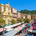 NICE, FRANCE - AUGUST 23, 2014: View of Cours Saleya - large pedestrian area famous for its flower, vegetable, spice and fish markets is one of the most popular places in Nice.; Shutterstock ID 264711230
