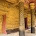 This image shows a Wat detail, door, wall, pole,  in  wat mai  (Luang Prabang, Laos)
