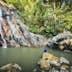 Bathers at Nam Tok Na Muang waterfall.