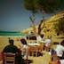 Dining at sunset on the beach beneath the caves - Matala, Iraklio Province, Crete