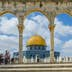 JERUSALEM, ISRAEL JUNE 10 2015: Israeli Temple Mount policeman greets the locals under the arches near the Dome of the Rock on the Temple Mount on June 10 2015 in the Old City of Jerusalem Israel.; Shutterstock ID 408810679; Your name (First / Last): Lauren Keith; GL account no.: 65050; Netsuite department name: Online Editorial; Full Product or Project name including edition: Middle East Online Highlights Update