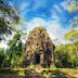 Ancient Khmer pre Angkor architecture. Sambor Prei Kuk temple ruins with giant banyan trees under blue sky. Kampong Thom, Cambodia travel destinations; Shutterstock ID 220864246; Your name (First / Last): Josh Vogel; Project no. or GL code: 56530; Network activity no. or Cost Centre: Online-Design; Product or Project: 65050/7529/Josh Vogel/LP.com Destination Galleries