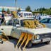MARGILAN, UZBEKISTAN - AUGUST 21: Old Lada car with brooms for sale at Kumtepa bazaar. Market in one the the biggest in the area running once a week. August 2016; Shutterstock ID 623087807; Your name (First / Last): Evan Godt; GL account no.: 65050; Netsuite department name: Online Editorial; Full Product or Project name including edition: central asia page