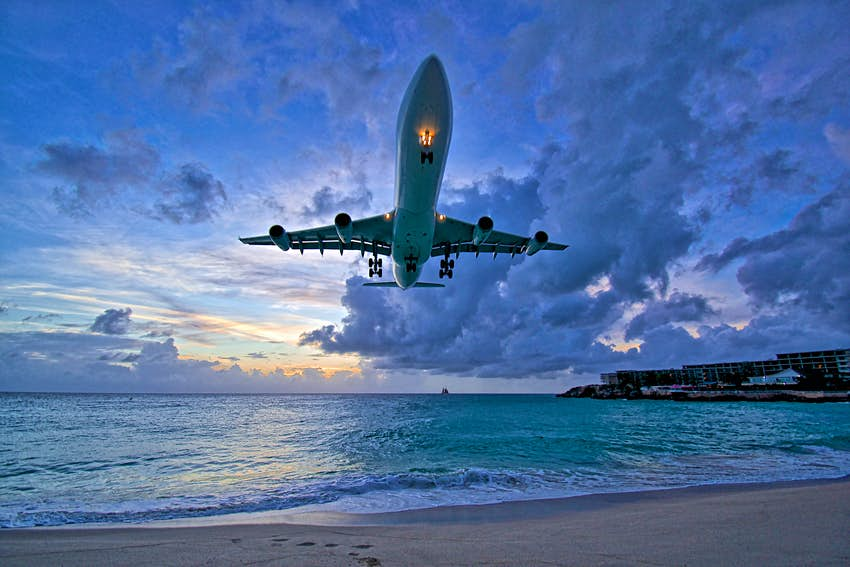 Air France A340 landing at Princess Juliana International Airport (PJIA) at sunset on St.Maarten.