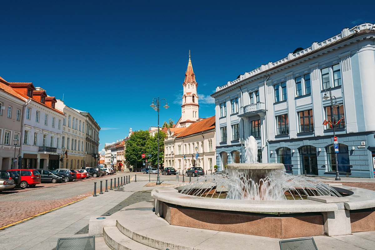 St. Nicholas Church and the fountain in Rotuses Square In Old Town. Vilnius.