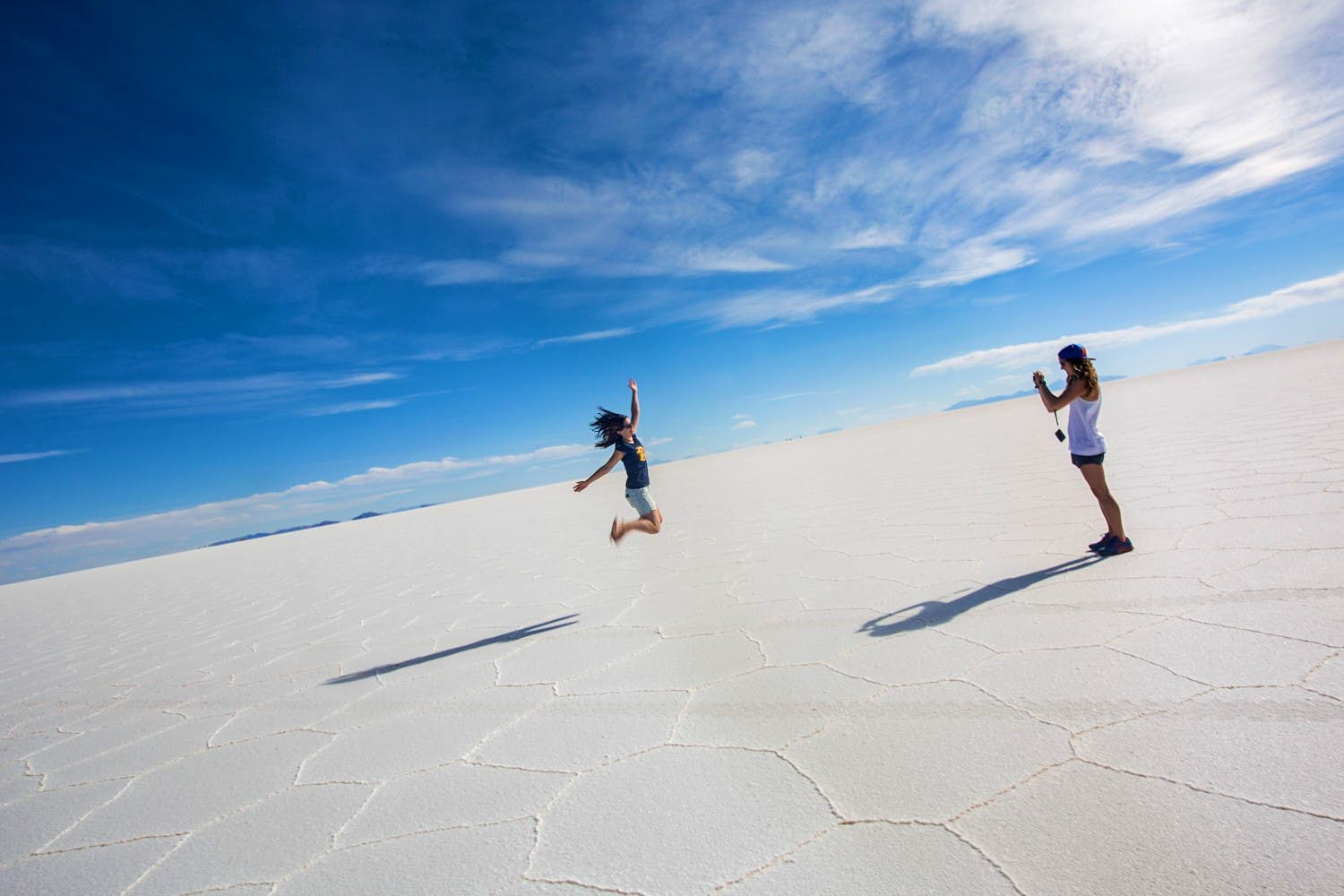 Two women jumping on the Bolivia Salt Flats