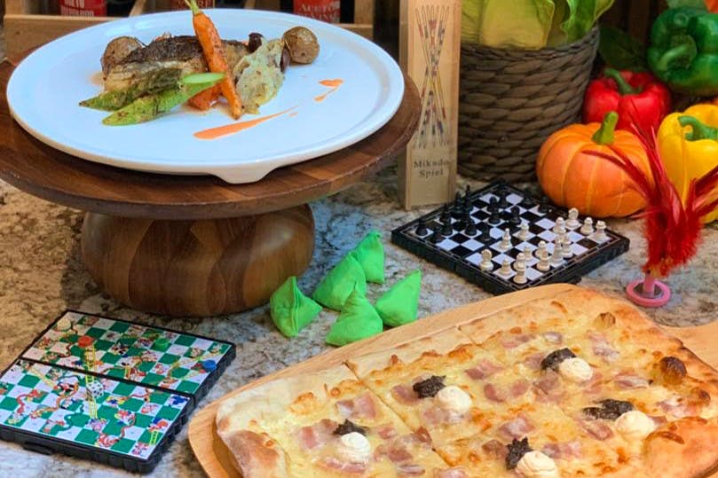 Board games beside plates of food