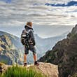 Self-portrait of a handsome tourist in the mountains of Madeira at Pico do Areeiro (Arieiro), while hiking to Pico Ruivo on a cloudy summer day