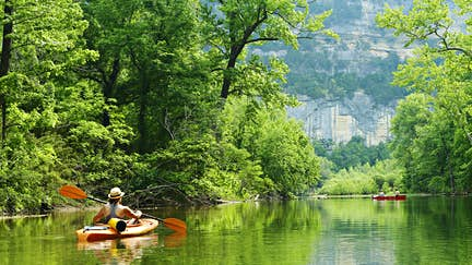 Kayakers and canoers on the Buffalo National River in Arkansas, as seen from Steel Creek Campground.