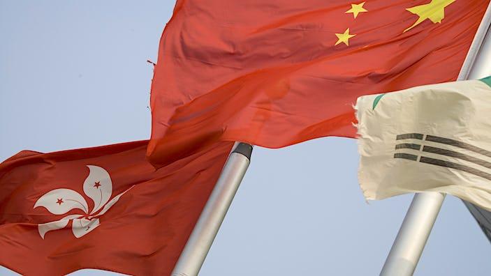 Hong Kong and Chinese flags, Golden Bauhinia, Wan Chai.