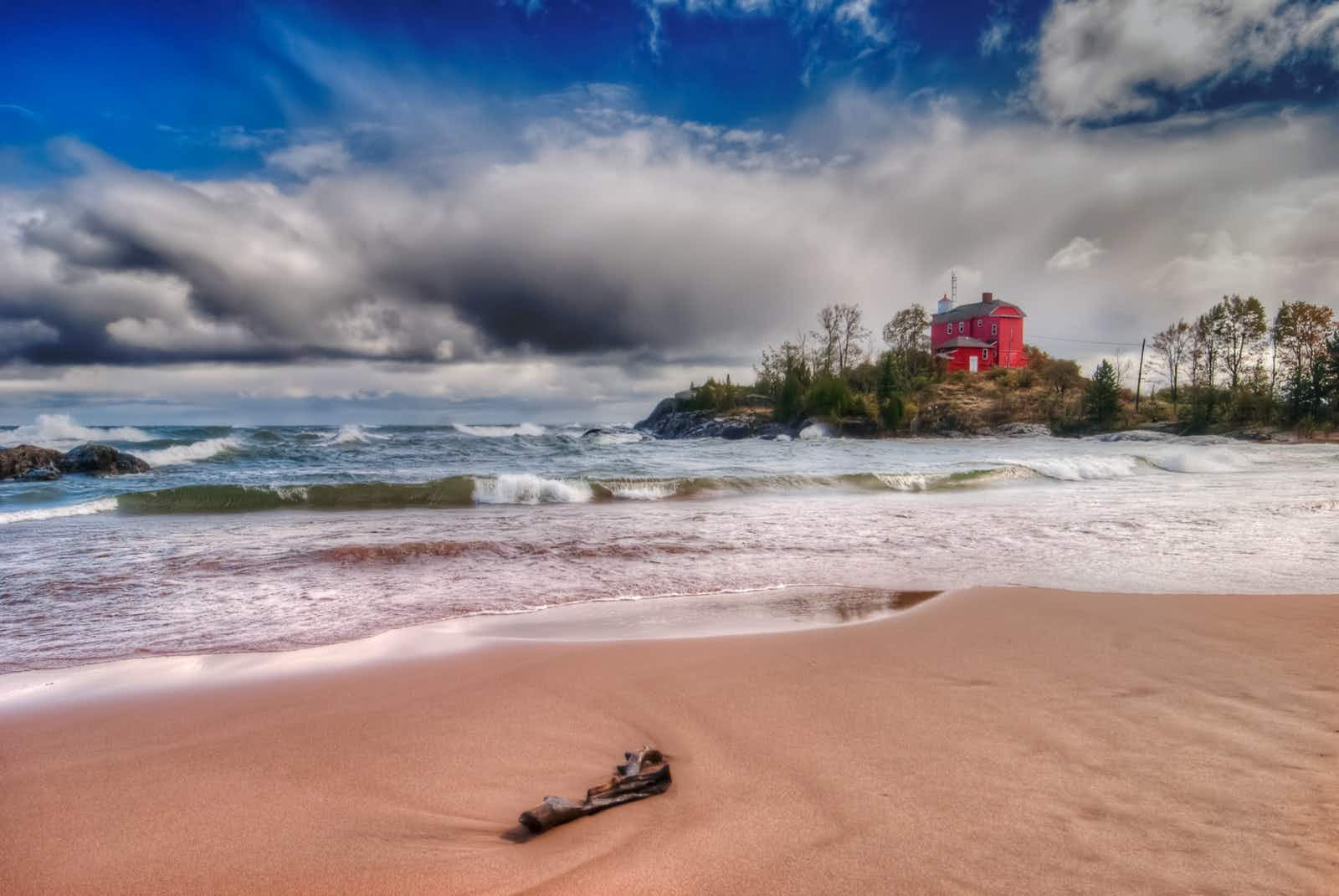 The Coast Guard Lower Harbor Lighthouse stands on an island just off the shores of Marquette, on Lake Superior. Marquette is a hub of adventure travel on Michigan's Upper Peninsula.
