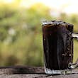 Thai iced black coffee signature local beverage on wooden background called oliang; Shutterstock ID 1227746524; Your name (First / Last): William Broich; GL account no.: 65050; Netsuite department name: Editorial ; Full Product or Project name including e