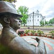 R8XH4K A bronze statue of William Faulkner looks out over Courthouse Square, May 31, 2015, in Oxford, Mississippi.