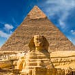 Great Sphinx of Giza with the Great Pyramid of Giza.