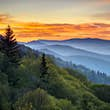 Sunrise over misty hills, as seen from Oconaluftee Overlook in the Great Smoky Mountains National Park.