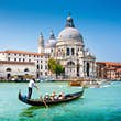 Traditional Gondola on Canal Grande with Basilica di Santa Maria della Salute in the background, Venice, Italy