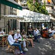 PARIS, FRANCE - JUNE 02: People have drinks at the terrace of 'Cafe de Flore' in the Latin Quarter district as bars and restaurants reopen after two months of nationwide restrictions due to the coronavirus outbreak on June 02, 2020 in Paris, France. The C