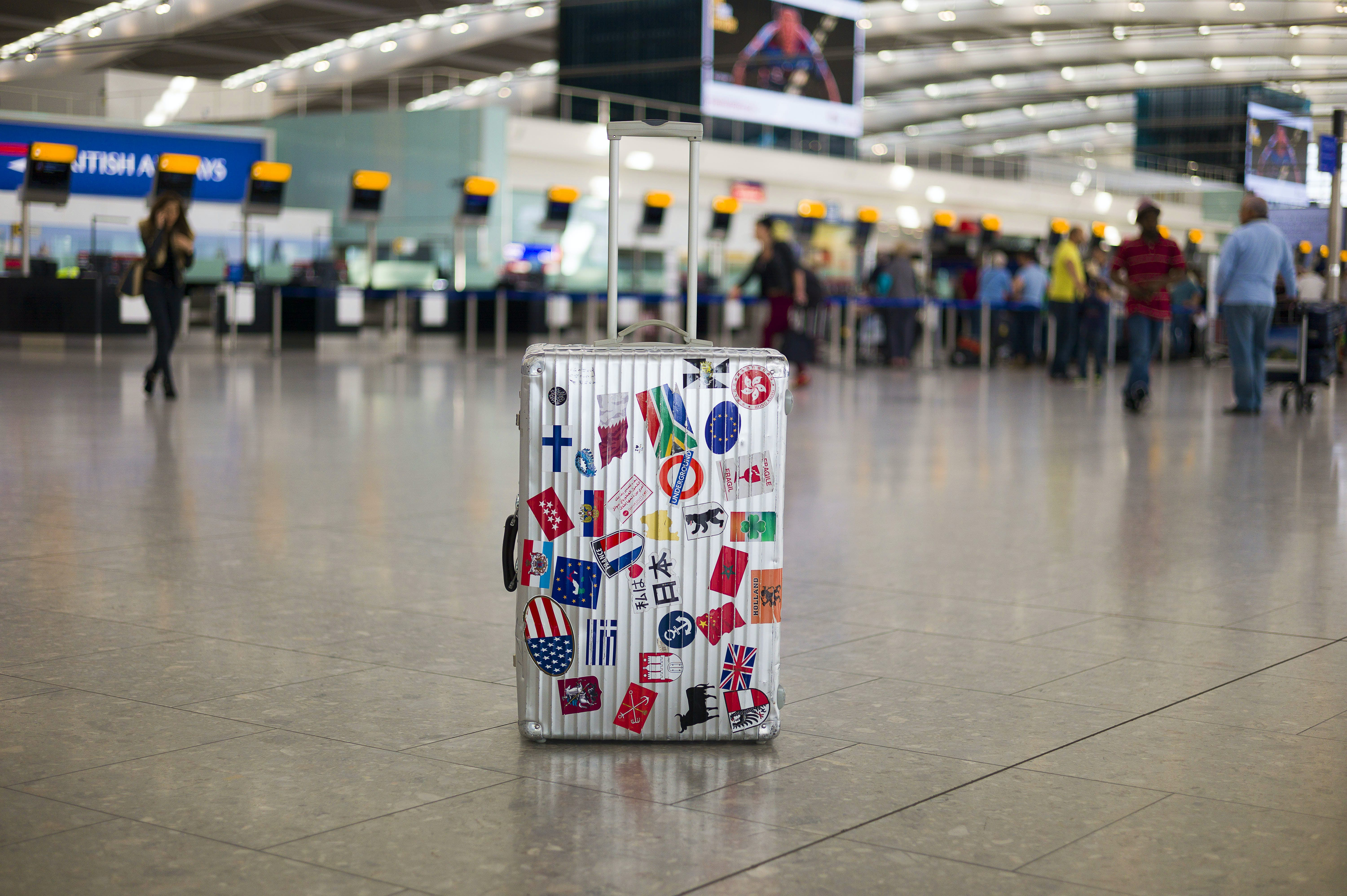 Unattended suitcase in departure zone at airport