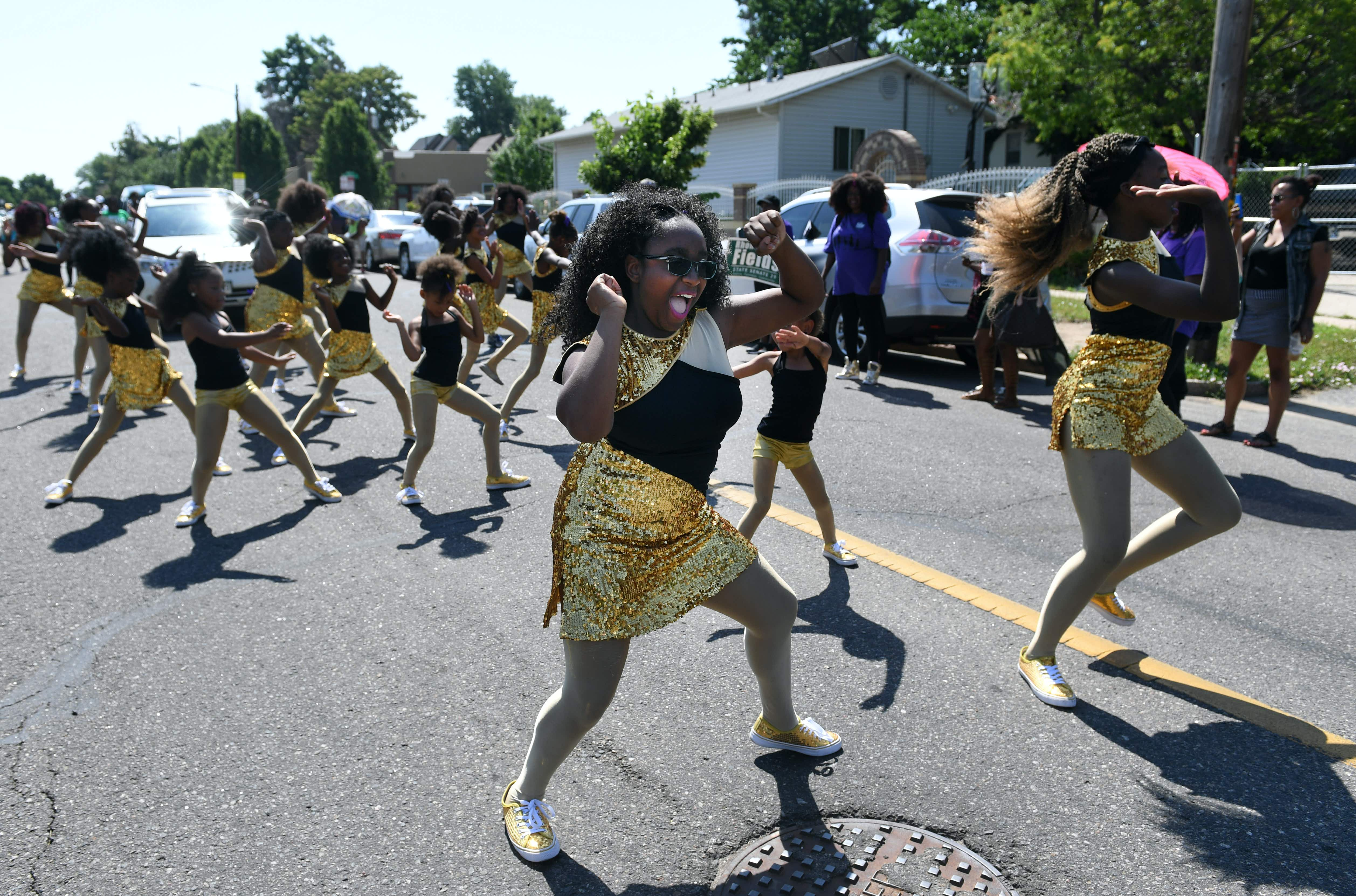 DENVER, CO - JUNE 18: Members of the DNA Dance Company make their way down E. 26th Ave. The 2016 Juneteenth Parade begins near Manuel High School in Denver and ends in the Five Points neighborhood for a festival. Juneteenth is the oldest known celebration
