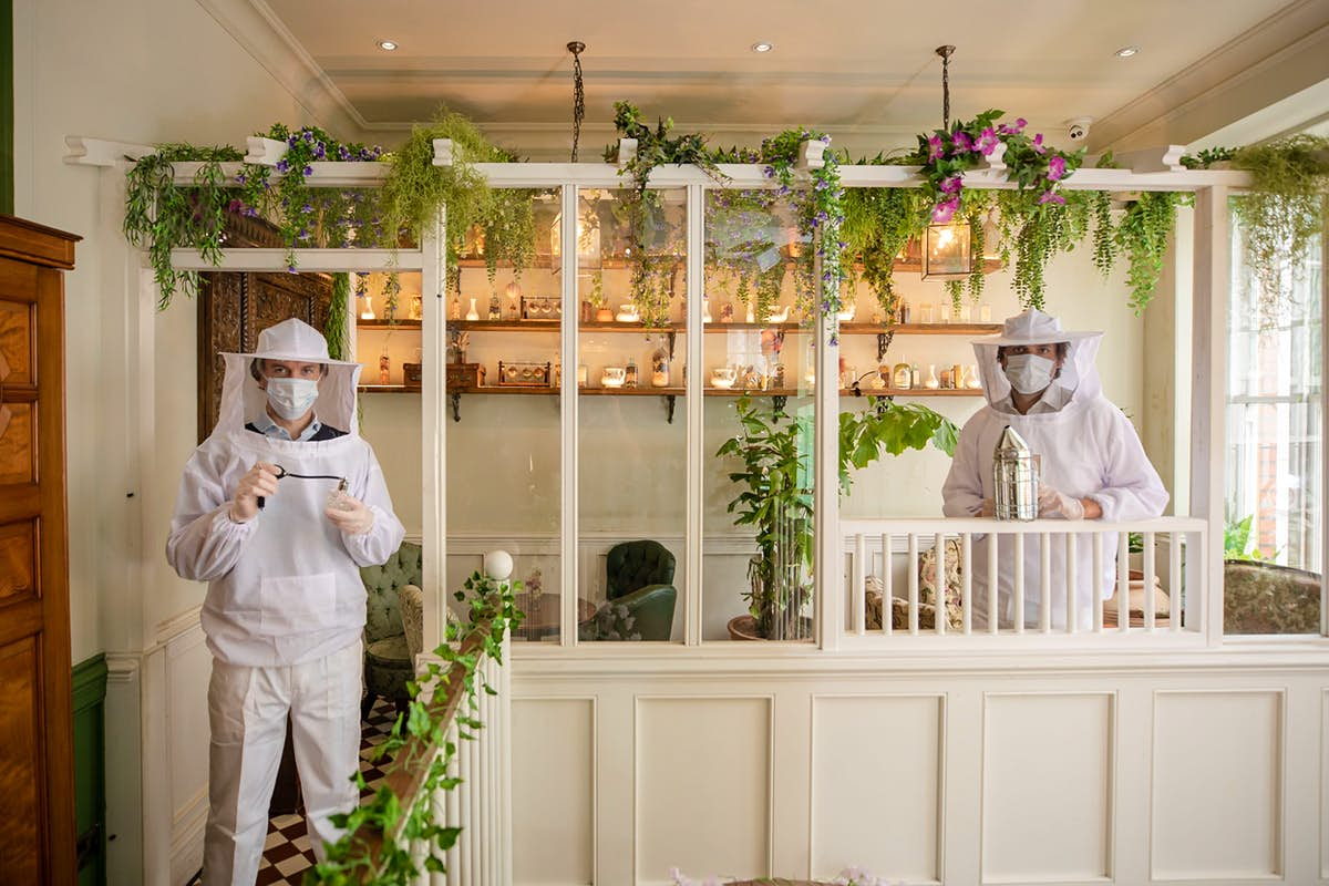 Staff at this London bar are dressing as beekeepers as a safety measure